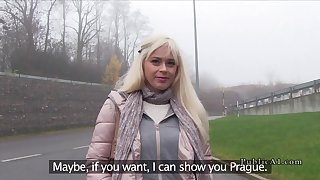 Blonde gets cock between tits in public