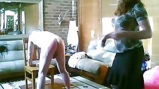 Beautiful Mistres  spanking her naughty boy with the strap